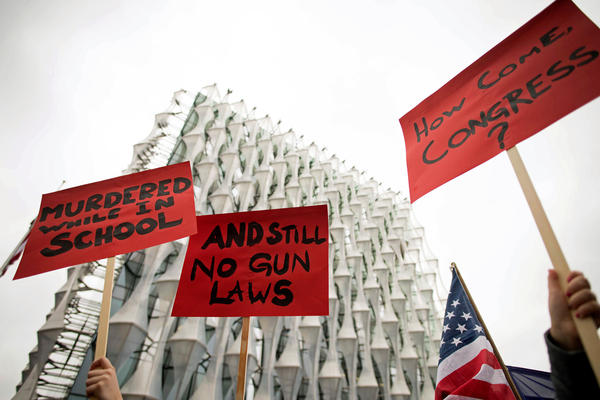The gun control protests went international: Demonstrators hold up signs outside the U.S. Embassy in London.