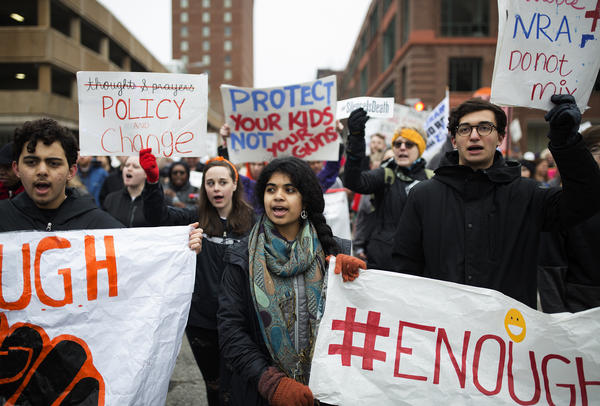 Mitali Sharma (center) marches with Clayton High School classmates in downtown St. Louis.