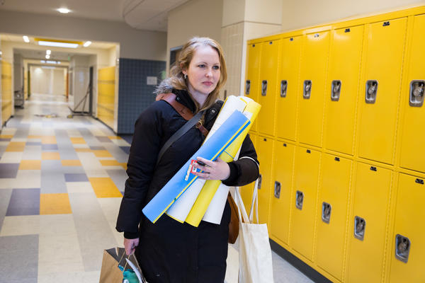 Maggie Webb, who teaches eighth-grade math, heads home from Clark Avenue School in Chelsea, Mass.