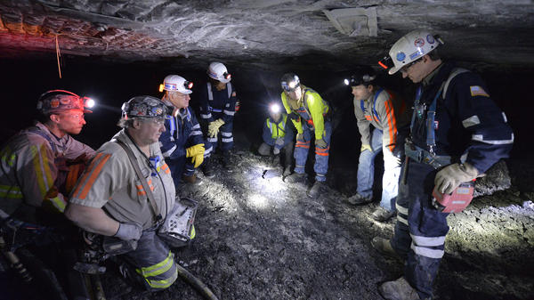Mine-safety officials speak with workers at the Gibson North mine in Princeton, Ind., in 2015.