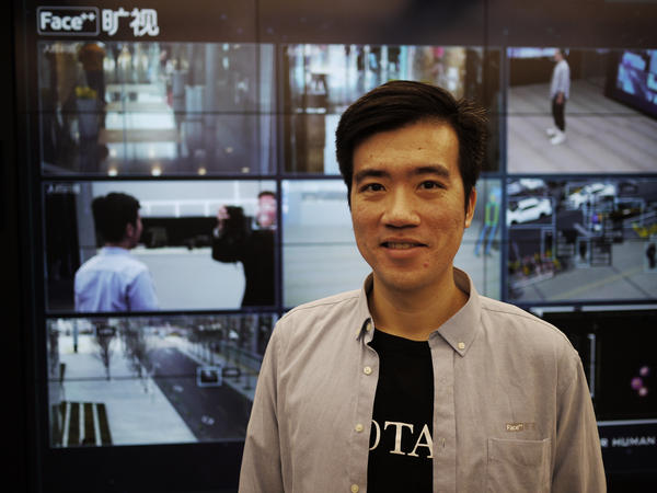 "Megvii Vice President Xie Yinan stands in front of several monitors exhibiting his company's facial recognition products. ""If a government is using it to control locals, we'd think twice about doing business with them,"" he says. ""Our principle is to empower humans, not to control them."""