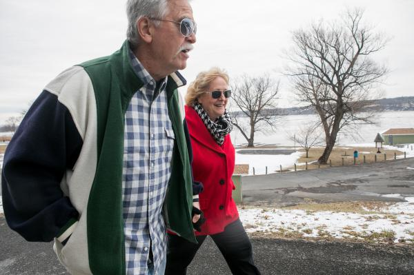 Ann Marie Owen walks with her husband, Bruce, near their home in Port Ewen, N.Y. Owen says the opioids prescribed by doctors made her feel sick and failed to ease her pain. Medical marijuana, she says, saved her life.
