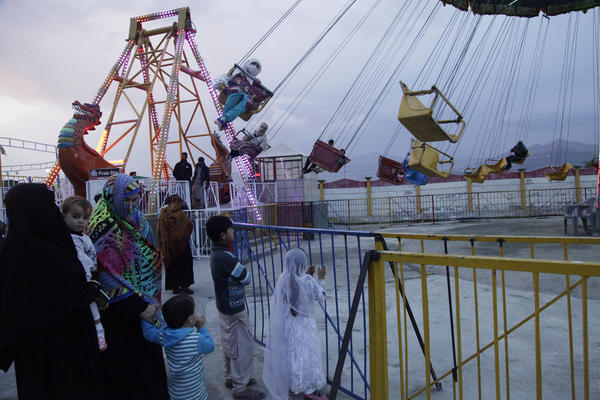 Women ride a carousel at the Swat Wonderland Amusement Park. It opened two summers ago. Residents say the park is evidence that life is returning back to normal, nearly a decade after the Pakistani army pushed out the Taliban from the Swat Valley.