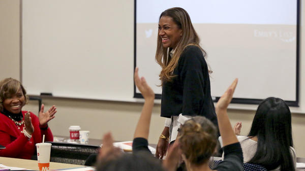 Letitia Plummer, a Houston dentist and candidate for Congress to represent Texas District 22, is applauded during a women's candidate training workshop at El Centro College in Dallas in December.