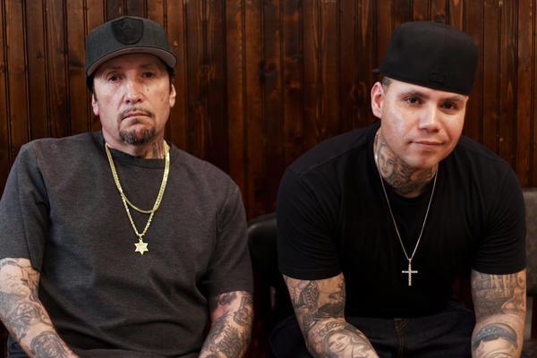 Freddy Negrete (left) at the Shamrock Social Club where he tattoos alongside his son, Isaiah.