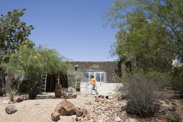 A team of contractors works on the renovation of a home in Phoenix. A decade after the U.S. housing crisis, some old habits are back, including house flipping.