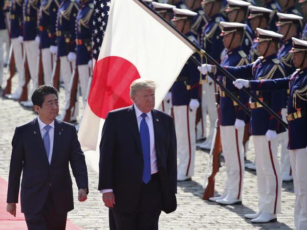 U.S. President Donald Trump reviews an honor guard during a welcome ceremony, escorted by Japanese Prime Minister Shinzo Abe, at Akasaka Palace in Tokyo, Nov. 6, 2017.