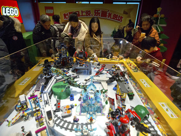 People look at a display of Lego creations at Hamleys toy store during its grand opening in Beijing last year. Exports remain strong for China, but consumption now accounts for 80 percent of the economy's growth.