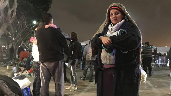 Deana Quczada of Honduras has been camping with her young children on the street in Tijuana for several days. Going back to the violence in her home country is not an option, she says.