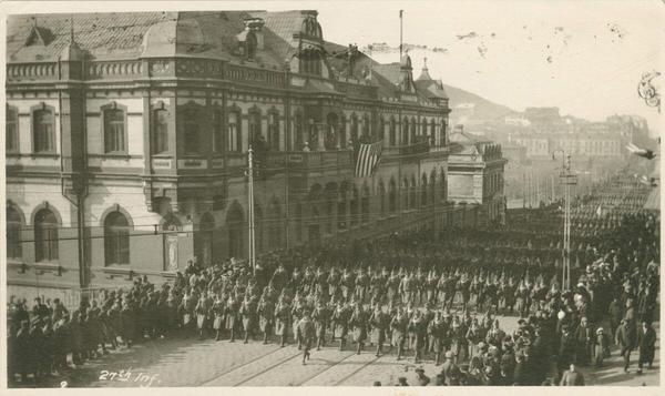U.S. troops wearing new sheep-lined coats march in downtown Vladivostok in November 1918.
