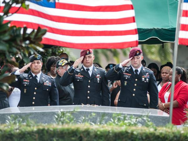 Members of the 3rd Special Forces Group, 2nd Battalion salute the casket of U.S. Army Sgt. La David Johnson at his burial service in Hollywood, Fla., on Oct. 21. Johnson and three other U.S. soldiers were killed in an ambush in Niger on Oct. 4.