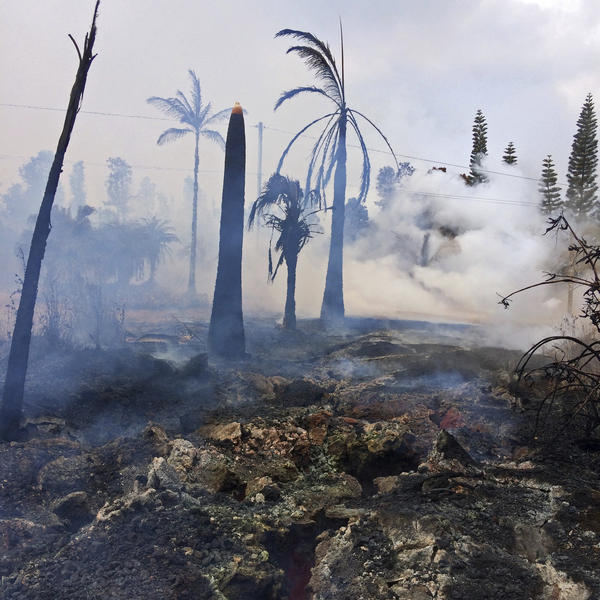 Severe ground cracks associated with what's known as Fissure 14 are seen in a burned-out landscape in Leilani Estates near the town of Pahoa, Hawaii, on Wednesday.