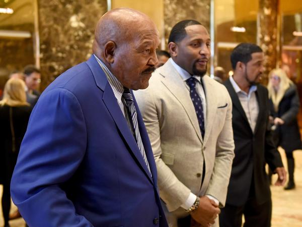 Retired NFL greats Jim Brown (left) and Ray Lewis address the media after meeting with then-President-elect Donald Trump at Trump Tower in New York in late 2016.