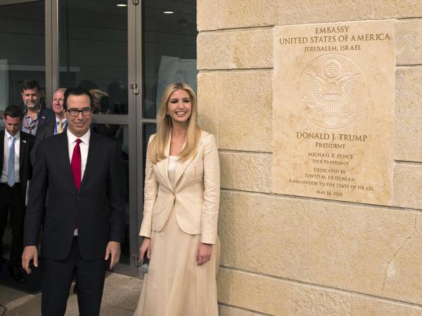 White House senior adviser Ivanka Trump and U.S. Treasury Secretary Steven Mnuchin unveil the entrance to the U.S. Embassy in Jerusalem.