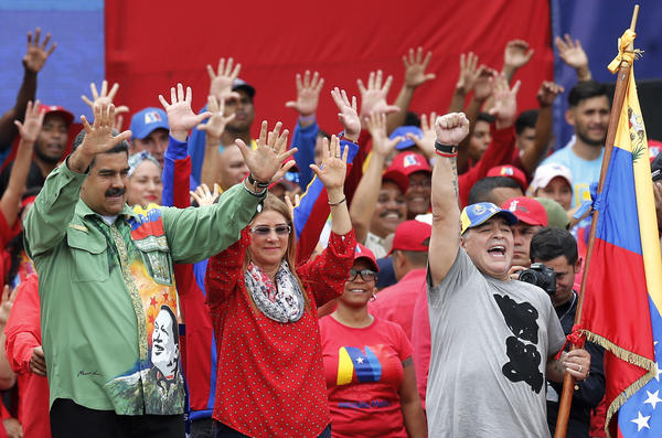 Venezuela's President Nicolás Maduro greets supporters during a closing campaign rally in Caracas, Venezuela, Thursday. Maduro is seeking a new six-year mandate.