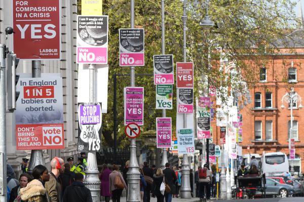 Posters in Dublin's city center urge votes in Friday's referendum.