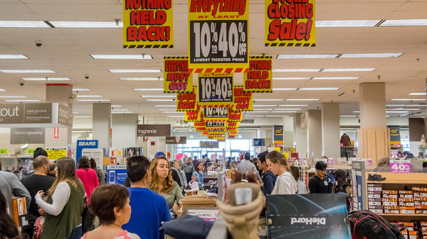 Sears Holdings Corp., which operates Sears and Kmart, said Thursday that it is closing 72 more of its stores. Here, shoppers look for deals at the last remaining Sears store in Chicago before it closes this summer.