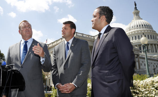 Rep. Jeff Denham, R-Calif., (left) speaks next to Rep. David Valadao, R-Calif., and Rep. Will Hurd, R-Texas, during a May 9 news conference on a discharge petition to force votes on immigration legislation.