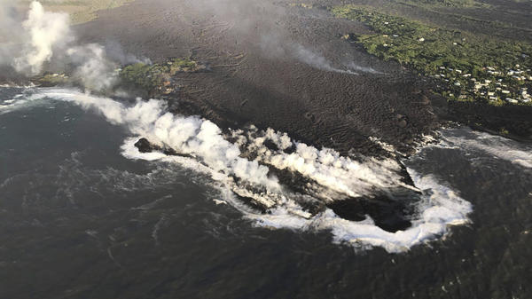 Lava enters the ocean at Kapoho Bay, Hawaii, on Tuesday. A U.S. Geological Survey morning overflight confirmed that lava had completely filled the bay.
