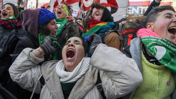 Abortion rights activists celebrate Thurdsay outside the Argentine Congress in Buenos Aires, shortly after lawmakers in the country's lower chamber passed a bill legalizing abortion. The bill's chances look uncertain in the upper chamber, but that did little to dampen excitement among its supporters.