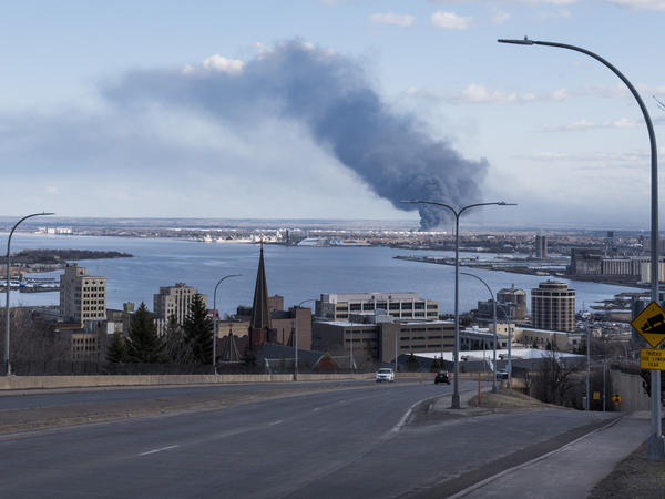 A fire at the Husky Oil Refinery on April 26, in Superior, Wis. The Environmental Protection Agency is planning to rescind regulations that would require refineries and chemical manufacturers to disclose information about emergency plans and the root causes of disasters.