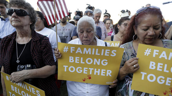 """Protesters in San Antonio pray during a Rally For Our Children event to protest the Trump administration's """"zero-tolerance"""" immigration policy."""