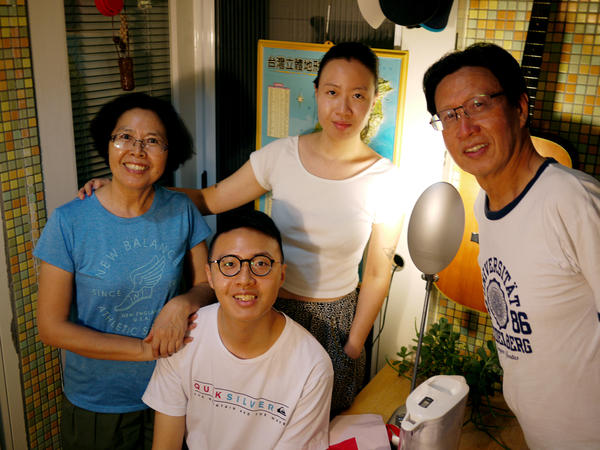 The Hsi family at their home in Taipei. While the father still identifies as Chinese, the youths say they're Taiwanese through and through.