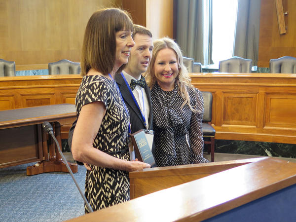Pat Ehrle is recognized as the National Down Syndrome Society's advocate of the year. The award was presented by her son, Craig Blackburn, and Sara Hart Weir, the organization's president and CEO.