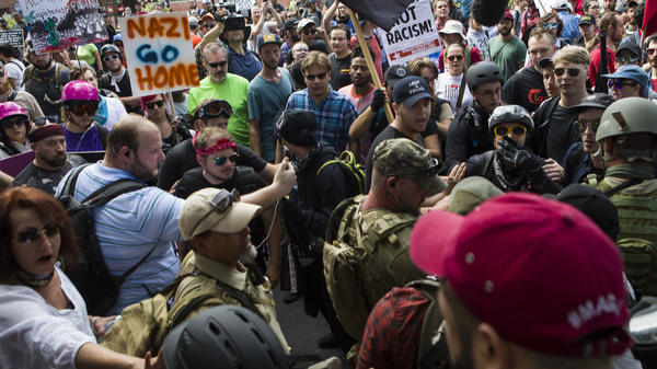"""Protesters and counterprotesters clash during the """"Unite the Right"""" rally on Aug. 12 in Charlottesville, Va. One woman died when a car drove into a crowd."""