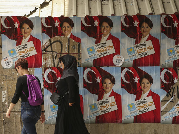 People walk past posters showing Meral Aksener, the presidential candidate from the Iyi (Good) Party, in Istanbul on Thursday.