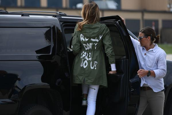 "First lady Melania Trump leaves Joint Base Andrews in Maryland wearing a jacket with the words ""I REALLY DON'T CARE. DO U?"" after her visit Thursday with migrant children who are being detained at the U.S.-Mexico border."