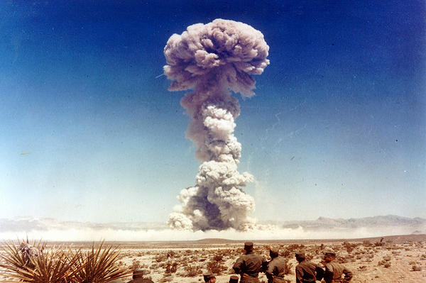 Military personnel watch a nuclear weapons test in Nevada in 1951.