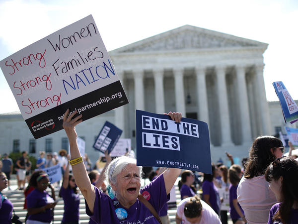 Abortion-rights proponents protest outside the U.S. Supreme Court on Tuesday. The retirement of Justice Anthony Kennedy set the stage for a battle over abortion rights unlike any in a generation.