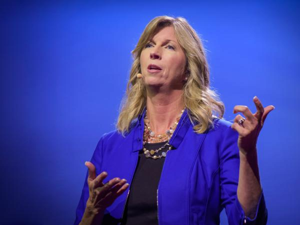 Regina Hartley on the TED stage.