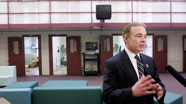 Garry Mead, assistant director of detention and removal for Immigration and Customs Enforcement, answers a reporter's question in 2007 in front of cells that housed immigrant families at the T. Don Hutto Residential Center in Taylor, Texas. After a suit by the ACLU, the center ended family detention, and ICE mostly avoided it until 2014.