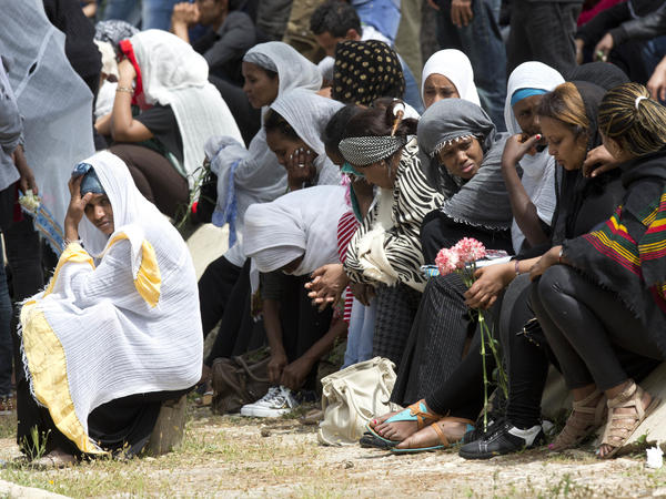Women grieve as the coffin of one of the 24 migrants who drowned while trying to reach Italy, is buried in Santa Maria Addolorata Cemetery on the outskirts of Valletta, Malta, on April 23, 2015. The migrants died as a smuggler's boat crammed with hundreds of people overturned off the coast of Libya.