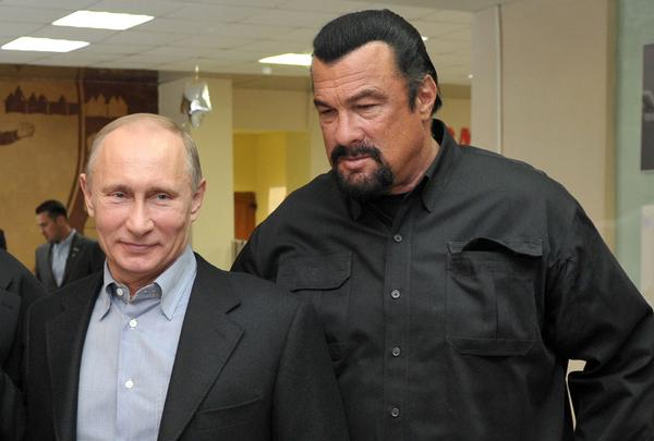 Russia's President Vladimir Putin and American action movie actor Steven Seagal visited a newly built wrestling school in Moscow in 2013.