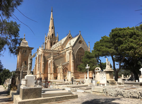 The neo-gothic Chapel of our Lady marks the center of Addolorata, Malta's main cemetery. Perched on a hilltop, the cemetery is covered with elaborate Catholic crypts and tombstones chiseled with the names of loved ones.
