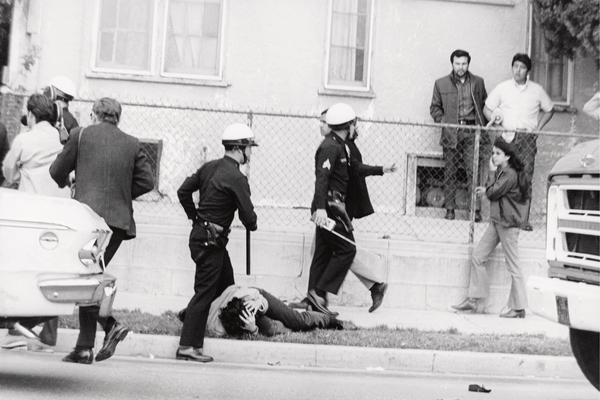 In 1968, Chicano students staged walkouts to protest unequal conditions in Los Angeles public schools. Prior to this shot, a student was hit in the head by police officers.