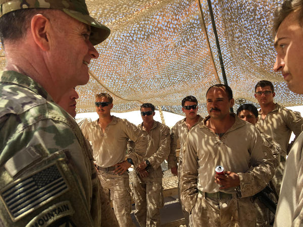 Maj. Gen. Walter Piatt, deputy commander of U.S. forces in Iraq, talks to Marines at the Um Jurius fire base, which supports Iraqi forces fighting ISIS. About 5,000 U.S. troops remain in Iraq.