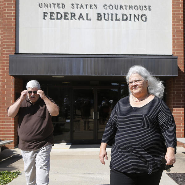Susan Bro, the mother of Charlottesville car attack victim Heather Heyer, walks out of federal court in Charlottesville, Va., with her husband on Thursday following a hearing at which James Alex Fields Jr. pleaded not guilty to multiple federal hate crime charges.