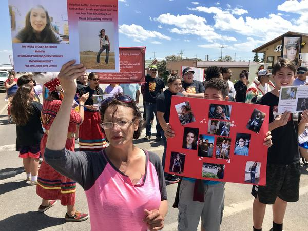 Loxie Loring helps lead a march to remember her daughter, Ashley Loring. She went missing from the Blackfeet Reservation over a year ago.
