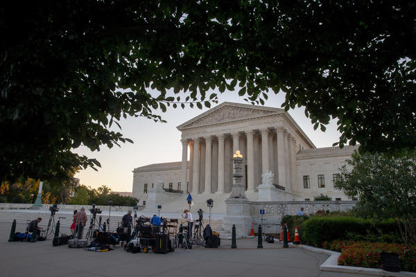 Journalists set up in front of the U.S. Supreme Court building on Monday in anticipation of President Trump's announcing his next Supreme Court nomination Monday evening.