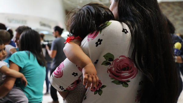 Dozens of migrant women and their children arrive at a bus station in McAllen, Texas, following their release by Customs and Border Protection last month.