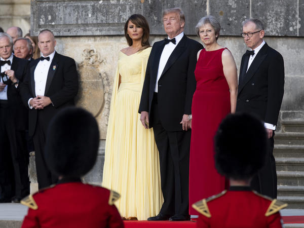 U.S. first lady Melania Trump, President Trump, British Prime Minister Theresa May and her husband, Philip May, watch a military performance ahead of a dinner in Oxfordshire, U.K., on Thursday.