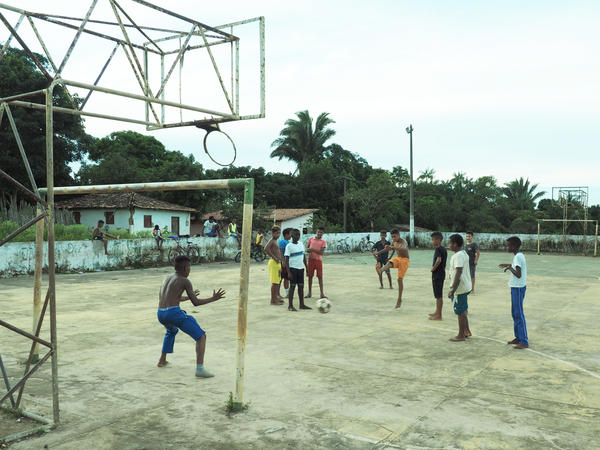 Young residents of Central play a pickup soccer game.