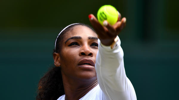 Serena Williams serves against Evgeniya Rodina of Russia during their Ladies' Singles fourth round match on day seven of Wimbledon on July 9, 2018 in London.