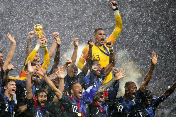 France players lift the World Cup trophy after their victory in the 2018 FIFA World Cup Final between France and Croatia in Moscow on Sunday.
