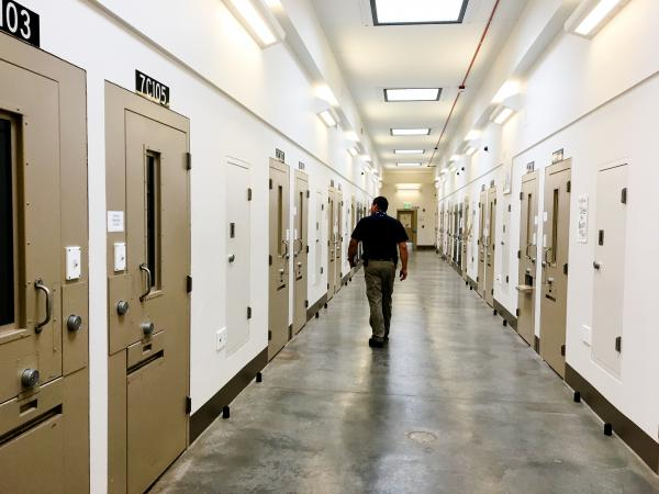 Chief of Security Joe Charvat walks the halls of the state penitentiary's Behavior Intervention Unit (BIU) — the prison's name for solitary confinement. Typically there are about 20 inmates in the cells, far fewer than in previous years.
