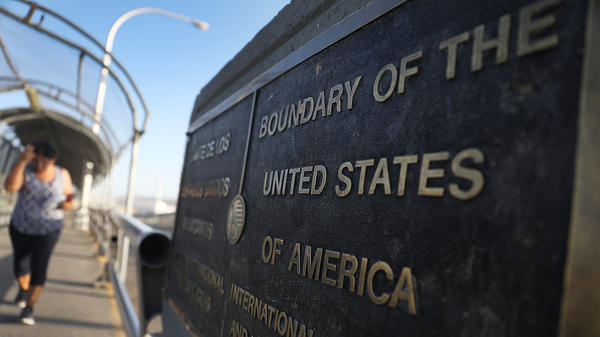A plaque marks the U.S. border on the Paso Del Norte Port of Entry bridge which connects the U.S. and Mexico on July 23, 2018. As many as 2,551 migrant children ages 5 to 17 were separated from their families after they crossed into the U.S. from Mexico along the border.